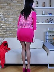 Red hot exotic babe changes into a bright fuchsia dress and suntan nylons
