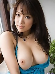 Lovely Asian chick flashes nice tits