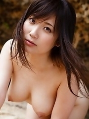 Busty and cute Japanese Mao Kurata goes to beach to get naked